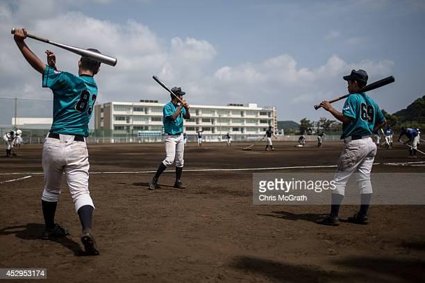 Players from Yokohama Minami warmup prior to the start of a practice game between the Shonan Boys and the Yokohama Minami on July 30 2014 in Yokosuka...