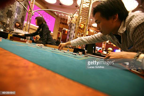 Players gamble at a roulette game at the Grand Lisboa casino on February 23 2008 in Macau China Macao has overtaken Las Vegas with a gambling revenue...