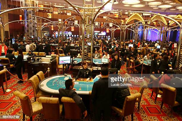 Players gamble at the Grand Lisboa casino on February 23 2008 in Macau China Macao has overtaken Las Vegas with a gambling revenue of 7 billion US...