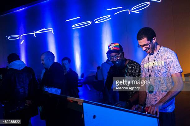 Players gather around an arcade machine at MAGfest 13 in National Harbor Md on January 24 2015 MAGfest is an annual convention held in the Washington...