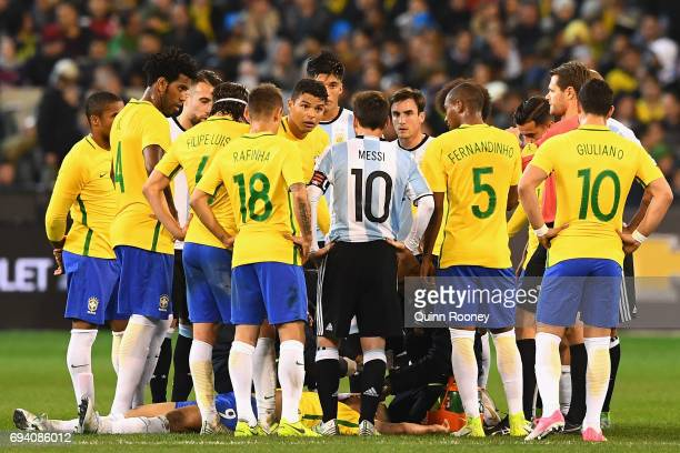 Players gather around as Jesus Gabriel of Brazil lays on the ground injured during the Brazil Global Tour match between Brazil and Argentina at...