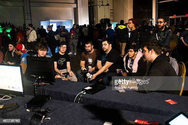 Players gather at a game station to play against each other at MAGfest 13 in National Harbor Md on January 24 2015 MAGfest is an annual convention...