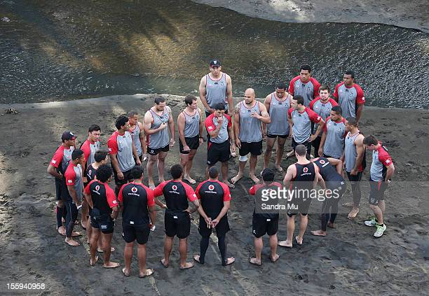 Players gather in rememberance of Sonny Fai before they train on the sand dunes during the New Zealand Warriors NRL training session at Bethells...