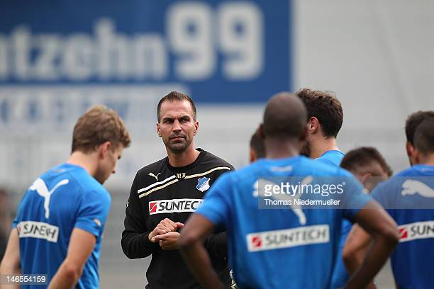 Players gather round head coach Markus Babbel during the first training session of TSG 1899 Hoffenheim for the upcoming Bundesliga season 2012/13 at...