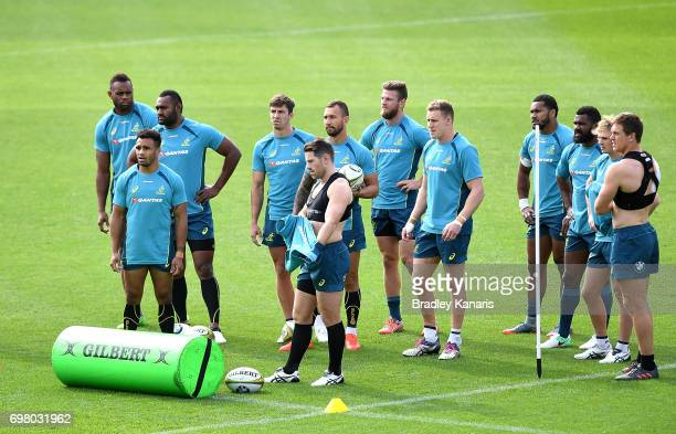 Players gather to hear instructions from the trainer during an Australian Wallabies training session at Ballymore Stadium on June 20 2017 in Brisbane...