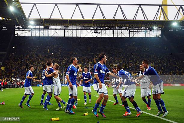 Players gee celebrate with supporters after the Bundesliga match between Borussia Dortmund and FC Schalke 04 at Signal Iduna Park on October 20 2012...