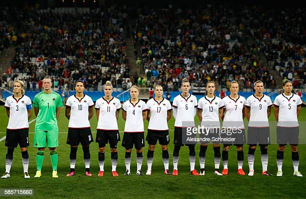 Players Germany stand for the national anthen before the match between Zimbabwe and Germany for summer olympics at Arena Corinthians on August 3 2016...