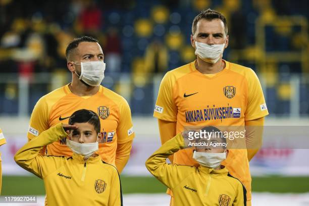 Players get on the ceremony with children receiving leukemia treatment, and wearing masks as part of 2 - 8 November Children With Leukemia Week ahead...
