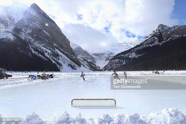 Players get ready before the start of their outdoor shinny hockey game during the 7th Annual Lake Louise Pond Hockey Classic on the frozen surface of...
