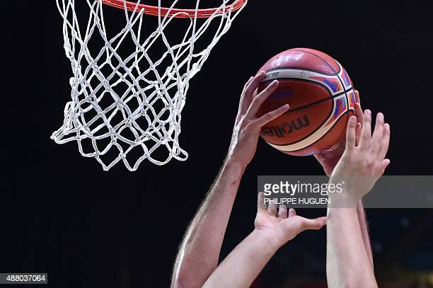 Players go for the ball during the round of 16 basketball match between Serbia and Finland at the EuroBasket 2015 in Lille northern France on...