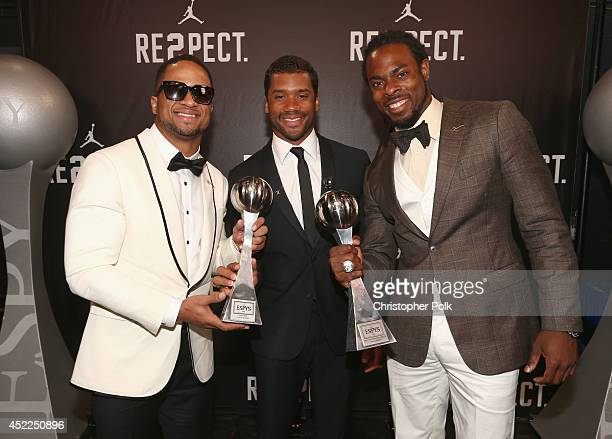 NFL Players Golden Tate Russell Wilson and Richard Sherman accepting award backstage for Best Team at The 2014 ESPYS at Nokia Theatre LA Live on July...