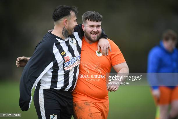 Players greet each other after Sunday league football between Syston Brookside FC and Shepshed Oaks FC on March 15, 2020 in Leicester, England.