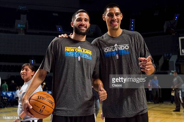 Players Greivis Vasquez and Gustavo Ayon pose for a picture during a training session of New Orleans Hornets and Orlando Magic with disabled people...