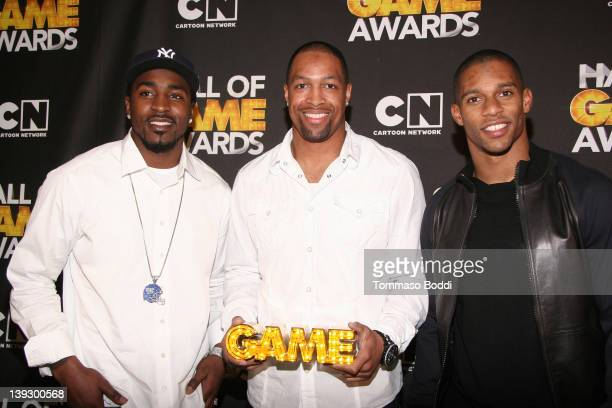 Players Hakeem Nicks, Victor Cruz and Michael Boley of the New York Giants pose in the press room during the Cartoon Network's Hall Of Game Awards at...
