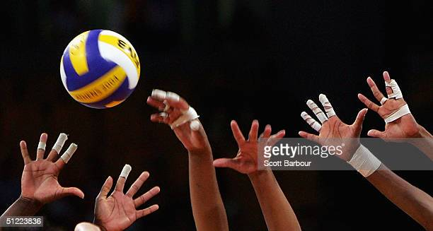 Players hands reach for the ball at the net during the China v Cuba women's indoor Volleyball semifinal match on August 26 2004 during the Athens...