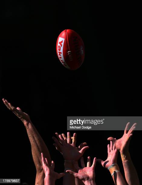 Players hands reach for the ball during the round 20 AFL match between the Essendon Bombers and the West Coast Eagles at Etihad Stadium on August 11...