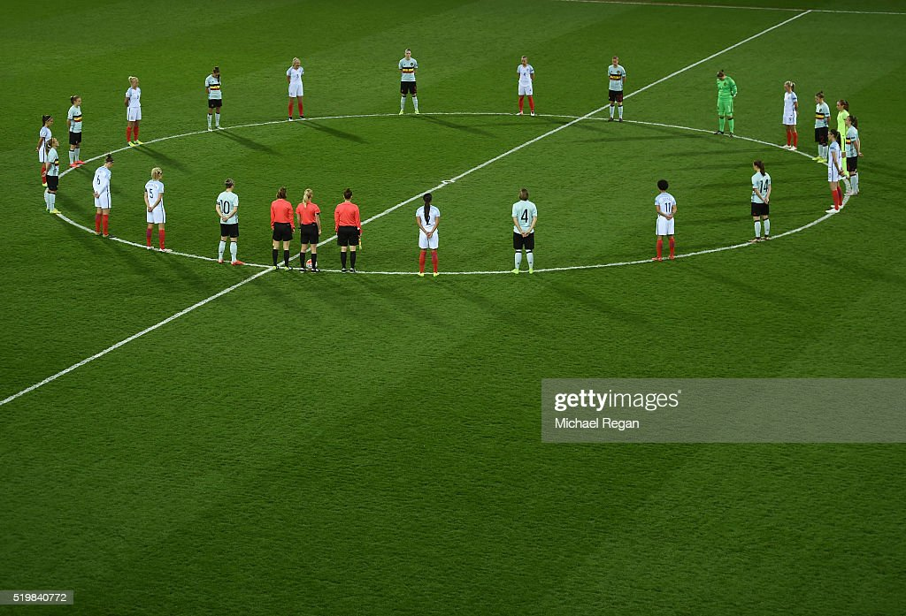 Players have a minute silence prior to the UEFA Women's European Qualifer between England and Belgium at The New York Stadium on April 8, 2016 in Rotherham, England.