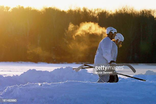 Players head towards their game near sunset in the 2013 USA Hockey Pond Hockey National Championships on February 8 2013 in Eagle River Wisconsin The...