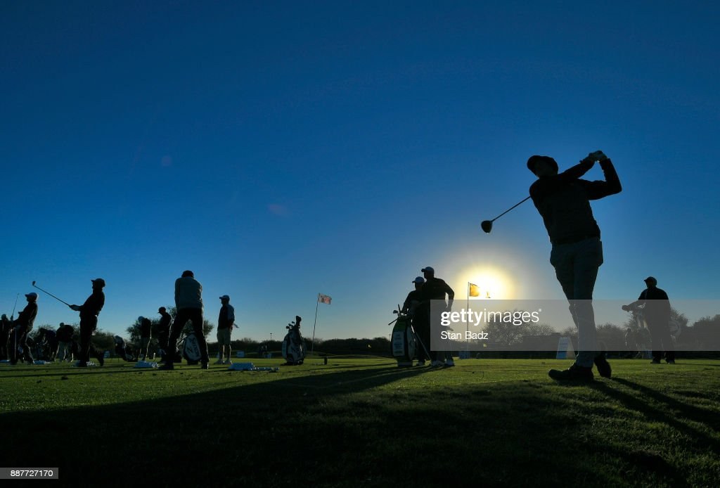 Players hit shots on the driving range at sunrise during the first round of the Web.com Tour Qualifying Tournament at Whirlwind Golf Club (The Cattail) on December 7, 2017 in Chandler, Arizona.