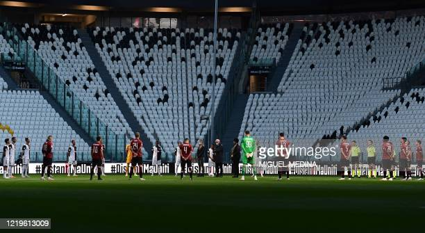Players hold a minute of silence for coronavirus victims prior to the Italian Cup semifinal second leg football match Juventus vs AC Milan on June 12...