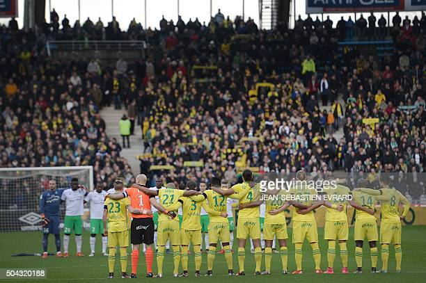 Players hold a minute of silence in homage to Guy Scherrer the former president of the FC Nantes who died on December 14 prior to the French L1...