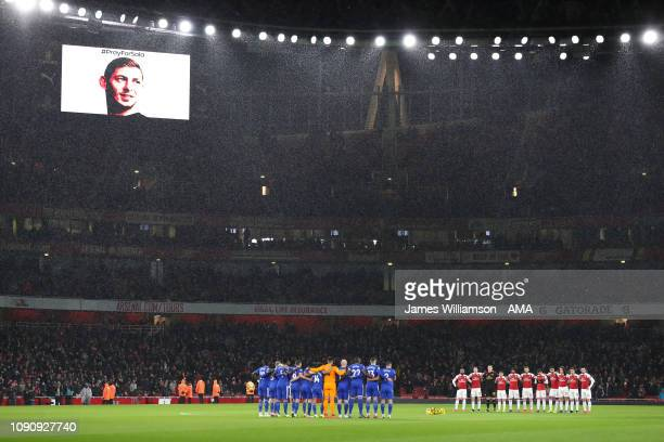 Players hold a minutes silence for missing Cardiff player Emiliano Sala during the Premier League match between Arsenal FC and Cardiff City at...