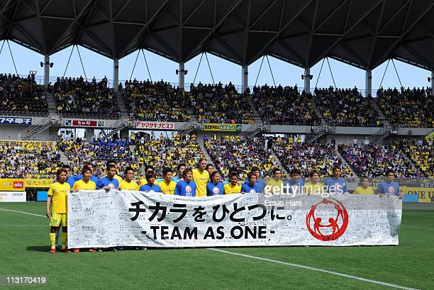 Players hold banner to support the earthquake and tsunami victims prior to the JLeague Division 2 match between JEF United Ichihara Chiba and FC...