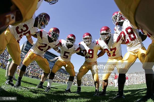 Players huddle around Reggie Bush prior to the USC Trojans game against the Notre Dame Irish at Notre Dame Stadium in South Bend, Indiana on October...
