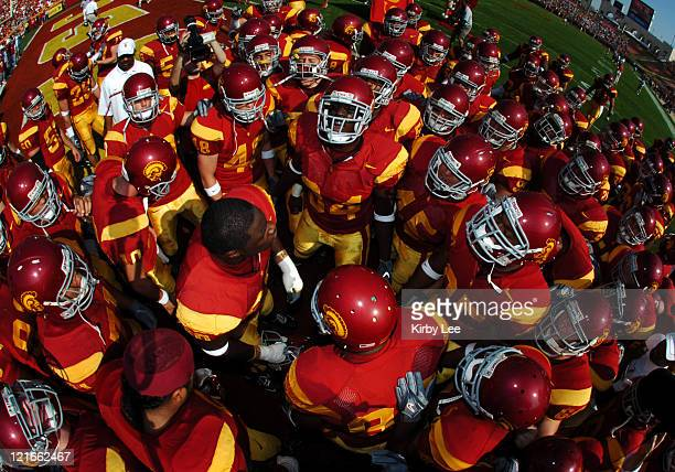 USC players huddle before 5513 victory over Washington State in Pacific10 Conference football game at the Los Angeles Memorial Coliseum in Los...