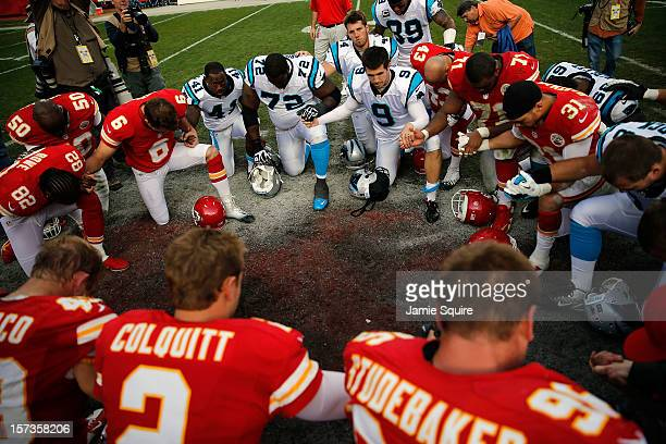 Players huddle in prayer following the Kansas City Chiefs 2721 victory over the Carolina Panthers at Arrowhead Stadium on December 2 2012 in Kansas...