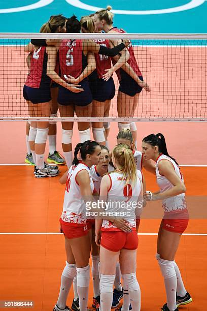 Players huddle on the court during the women's semifinal volleyball match between Serbia and USA at the Maracanazinho stadium in Rio de Janeiro on...