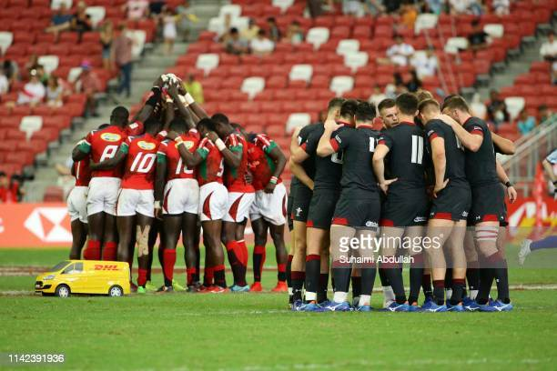 Players huddle prior to the Pool C match between Kenya and Wales on day one of the HSBC Rugby Sevens Singapore at the National Stadium on April 13...