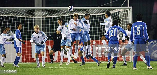 Players in action as Shanghai Shenhua kicks a free kick during the AFC Champions League 2007 match between the Sydney FC of Australia and Shanghai...