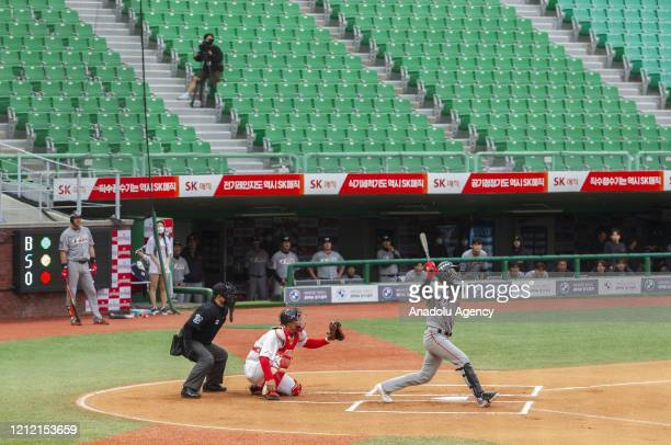 Players in action during a baseball game between SK Wyverns and Hanwha Eagles at SK Wyverns club's Happy Dream Ballpark without spectators due to the...