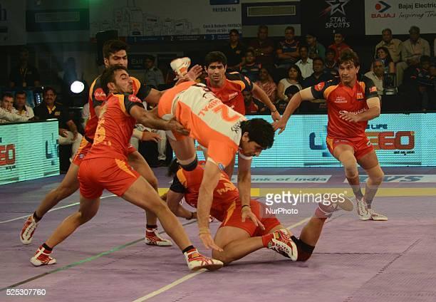 Players in action during the Pro Kabaddi league match between Bengaluru Bulls and Puneri Pal tan in Kolkata India on Saturdayday July 25 2015