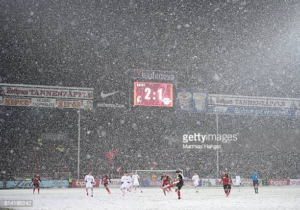 Players in action in the snow during the Second Bundesliga match between SC Freiburg and RB Leipzig at SchwarzwaldStadion on March 7 2016 in Freiburg...