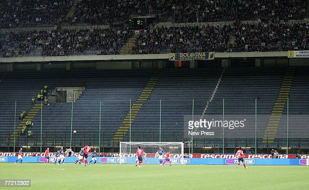 Players in action infront of half empty seats during the match between Inter Milan and Napoli at the San Siro stadium on October 6 2007 in Milan Italy
