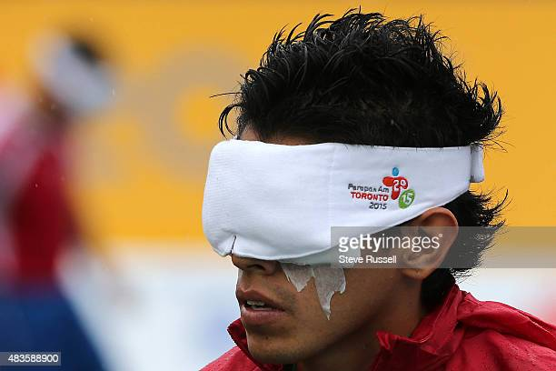 TORONTO ON AUGUST 10 Players including Francisco Rangel of Mexico wear a blindfold and has his eyes taped up as well as does each of the four players...