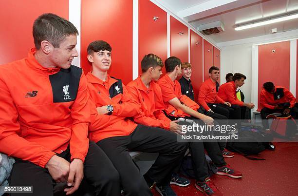 U18 players including Liam Coyle Anthony DriscollGlennon Adam Lewis Laim Millar and Glen McAuley sit in the temporary dressing room at Anfield on...