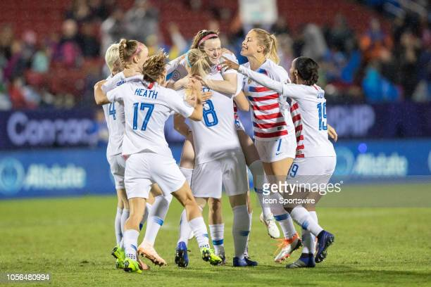 USA players including midfielder Tobin Heath defender Abby Dahlkemper and midfielder Julie Ertz celebrate a first half goal by midfielder Rose...