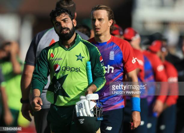 Players including Pakistan's Shadab Khan leave the field after England won the second T20 international cricket match between England and Pakistan at...