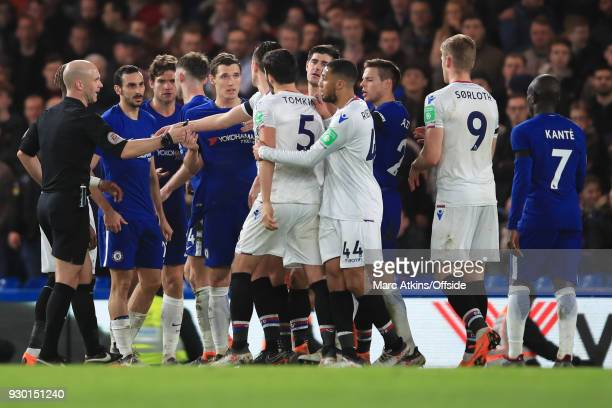 Players intervene as Andreas Christensen of Chelsea appears to clash with James Tomkins of Crystal Palace during the Premier League match between...