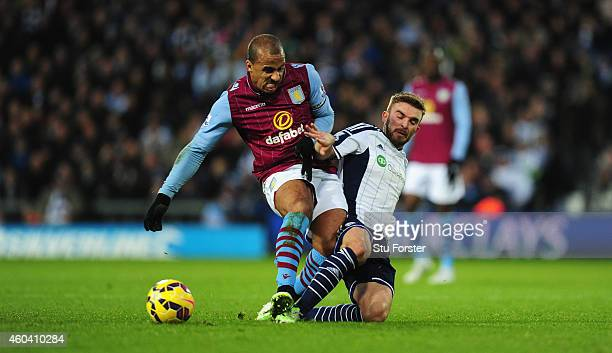 WBA players James Morrison is challenged by Gabriel Agbonlahor of Villa during the Barclays Premier League match between West Bromwich Albion and...