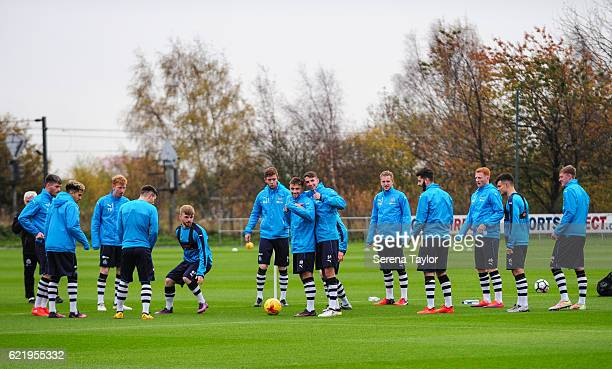 Players Jamie Holmes and Dan Barlaser give the thumbs up during The Newcastle United Training Session at The Newcastle United Training Centre on...
