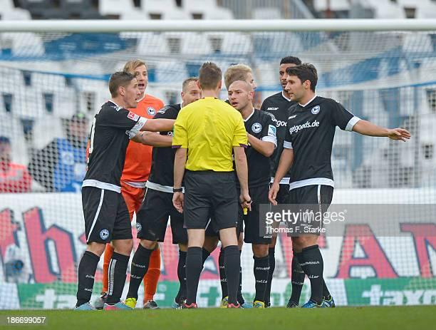 Players Jan Fiesser Patrick Platins Arne Feick Philipp Riese Felix Burmeister Marcel Appiah and Stephan Salger of Bielefeld argue with referee...