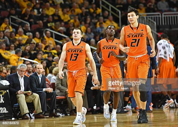 Players Jawun Evans Phil Forte III and Lindy Waters III of the Oklahoma State Cowboys walk up the court against the Wichita State Shockers during the...