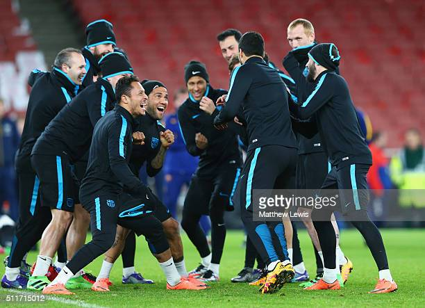 Players joke during a FC Barcelona training session ahead of their UEFA Champions League round of 16 first leg match against Arsenal at the Emirates...