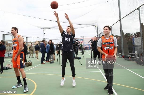 AFL players Josh Kelly and Toby Greene of the GWS Giants shoot baskets during the NBL First Ever Apparel Uniform Launch athe the Ultimo Community...