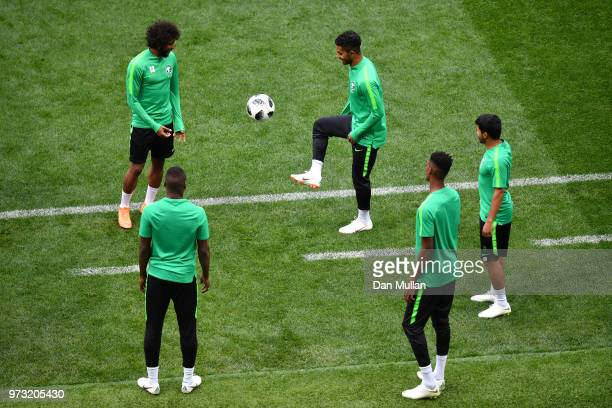 Players juggle the ball during a Saudi Arabia training session ahead of the 2018 FIFA World Cup opening match against Russia at Luzhniki Stadium on...