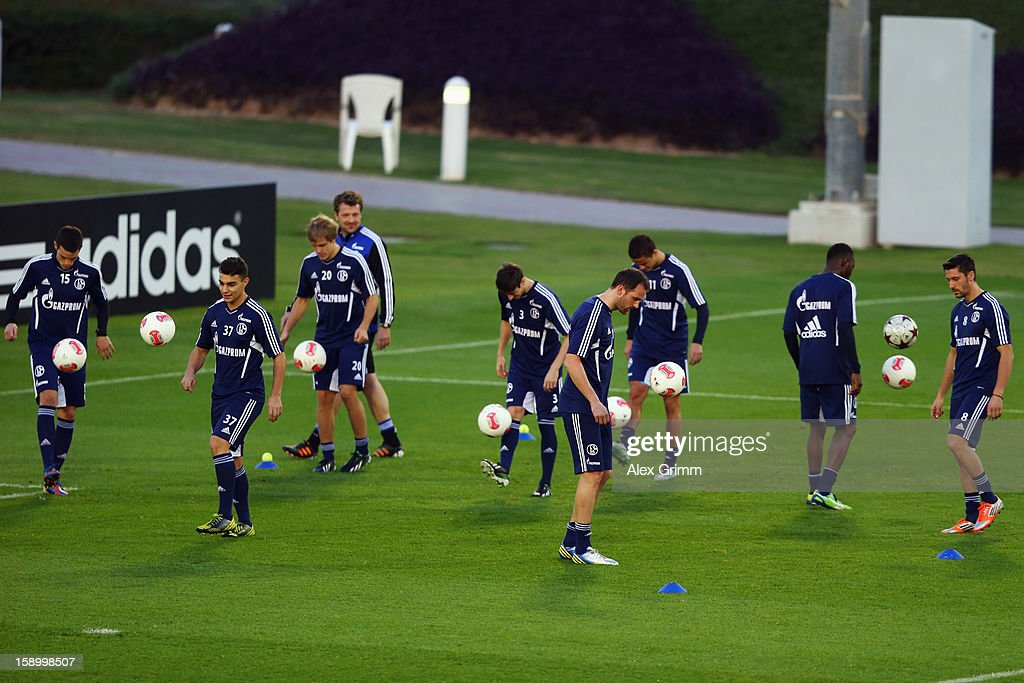 Players juggle with the ball during a Schalke 04 training session at the ASPIRE Academy for Sports Excellence on January 5, 2013 in Doha, Qatar.